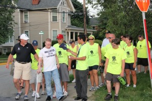 Pa. Hero walkers accompany Colin 9in white shirt) at the end of his walk