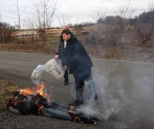 Burning an effigy of Old Man Winter