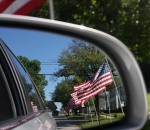 Flags as seen through the rear view mirror...