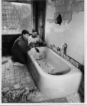 Dismantling a bath tub in the White House during a 1950 remodeling