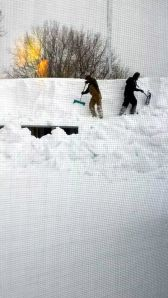 Shoveling snow off roof. Photo by Kirsten