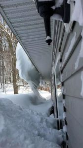 Kirsten's gutter overhung with snow and ice. Photo by Kirsten