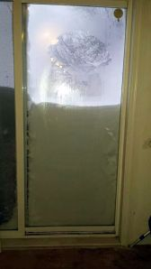 Snow blocking Kirsten's door --- photo by Kirsten